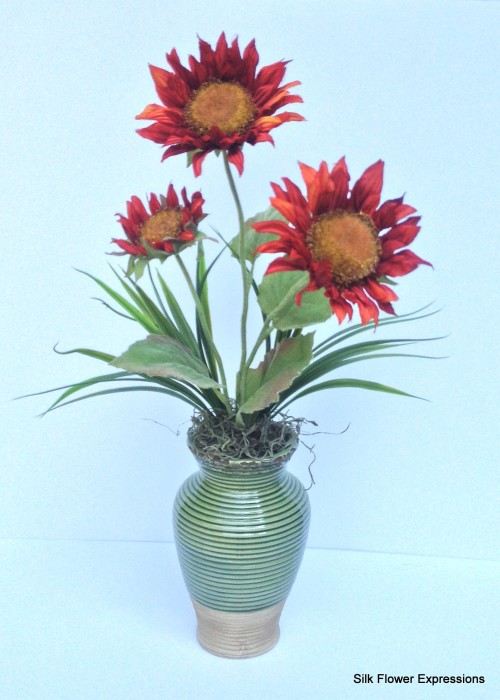 Red Sunflowers in Green Ceramic Vase