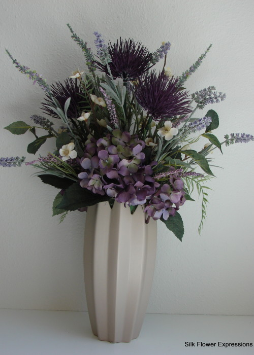 Purple Thistles with Lavender and purple Hydrangea in Gray Ceramic Vase